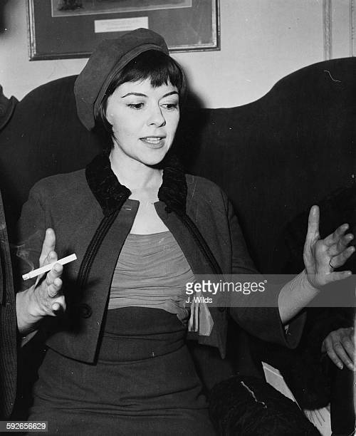 Actress Dorothy Tutin smoking a cigarette as she speaks at a press conference to announce the upcoming plans for the Royal Shakespeare Company at the...
