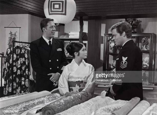 Actress Doug McClure Nancy Kwan and David Hartman in a scene from the movie Nobody's Perfect