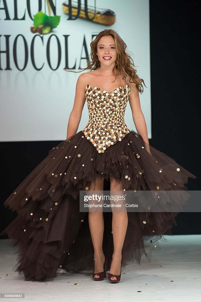 Actress Dounia Coesens walks the runway and wears 'Le Carrlousel Enchante', a chocolate dress made by designer Nicolas Fafiotte and chocolate maker Sebastien Bouillet, during the Fashion Chocolate Show at Salon du Chocolat at Porte de Versailles, in Paris.