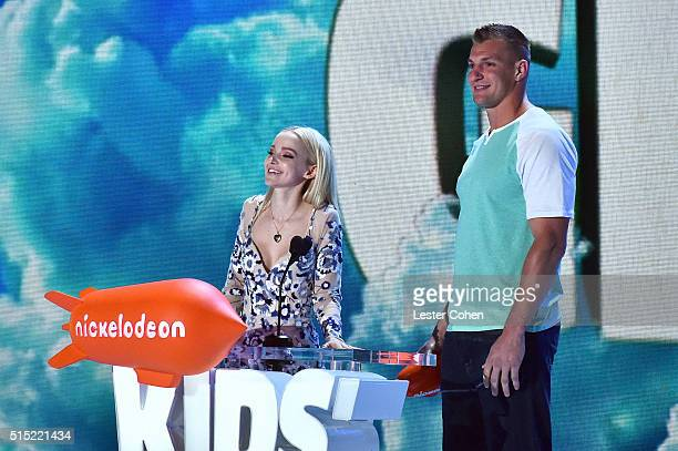 Actress Dove Cameron and Football player Rob Gronkowski speak onstage during Nickelodeon's 2016 Kids' Choice Awards at The Forum on March 12 2016 in...