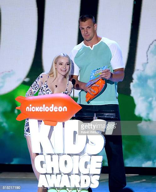 Actress Dove Cameron and NFL player Rob Gronkowski speak onstage during Nickelodeon's 2016 Kids' Choice Awards at The Forum on March 12 2016 in...