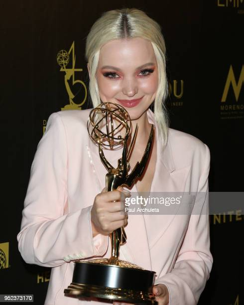 Actress Dove Cameron attends the press room at the 45th Annual Daytime Creative Arts Emmy Awards at the Pasadena Civic Auditorium on April 27 2018 in...
