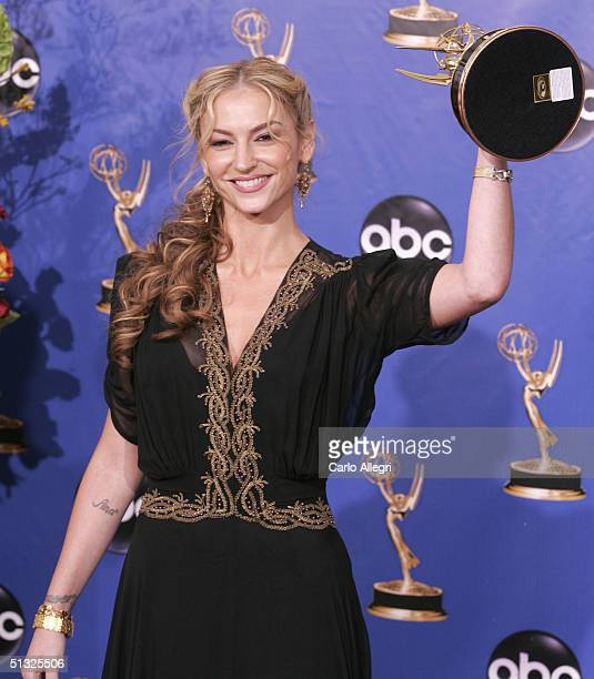 Actress Drea de Matteo winner for Outstanding Supporting Actress in a Drama Series for 'The Sopranos' poses with her Emmy backstage during the 56th...