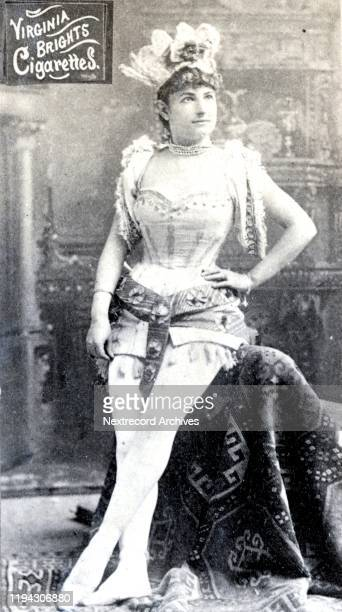 Actress dressed in indigenous-inspired feathered costume with corset, depicted on collectible tobacco card from the Actors and Actresses series from...