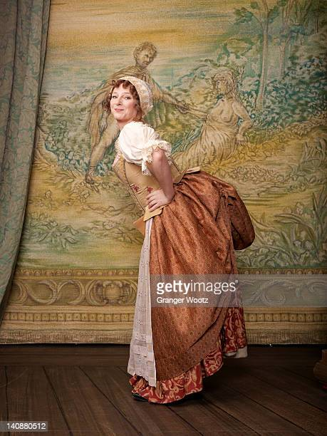 Actress dressed in old-fashioned costume on stage