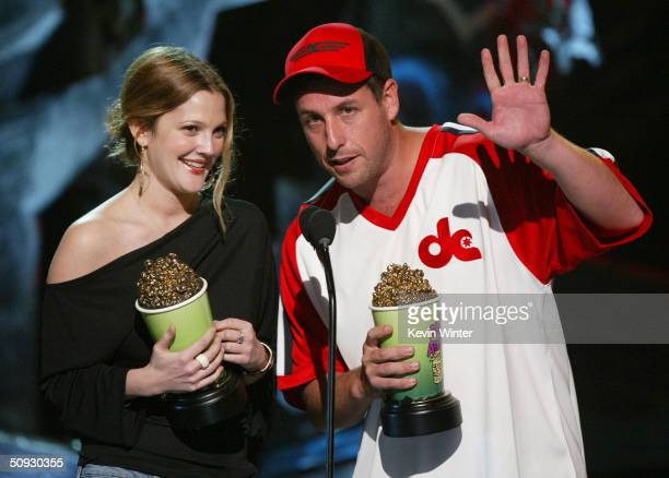 Actress Drew Barrymore and Actor Adam Sandler on stage at the 2004 MTV Movie Awards at the Sony Pictures Studios on June 5 2004 in Culver City...