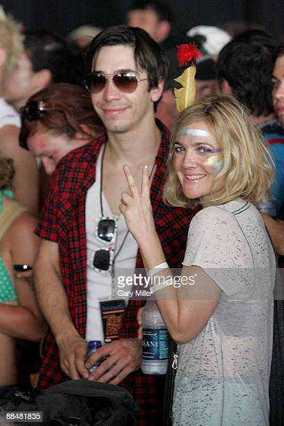 Actress Drew Barrymore and actor Justin Long watch Bon Iver perform during the 2009 Bonnaroo Music and Arts Festival on June 13 2009 in Manchester...