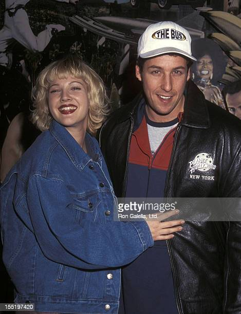 Actress Drew Barrymore and comedian Adam Sandler attend 'The Wedding Singer' Memorabilias Donated to Planet Hollywood on February 5 1998 at Planet...