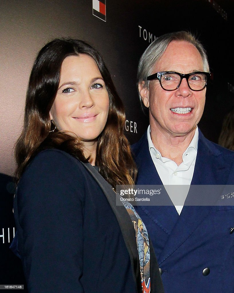 Actress Drew Barrymore and fashion designer Tommy Hilfiger attend Tommy Hilfiger New West Coast Flagship Opening on Robertson Boulevard on February 13, 2013 in West Hollywood, California.