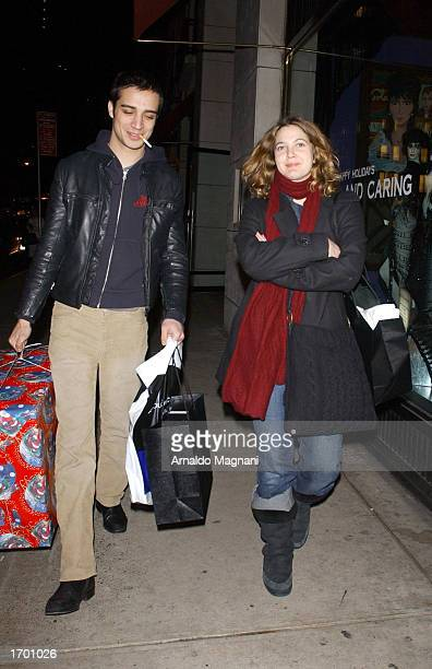 Actress Drew Barrymore and her boyfriend Fabrizio Moretti drummer of The Strokes walk down the street after shopping at Barney's on Madison Ave...