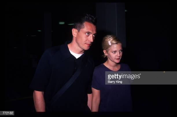 Actress Drew Barrymore and her husband Jeremy Thomas attend the premiere of Bad Girls April 19 1994 in Los Angeles CA The film tells the story of...