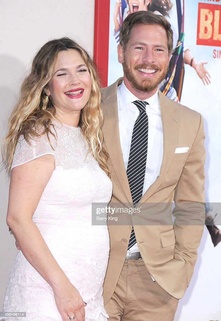 Actress Drew Barrymore (L) and husband actor Will Kopelman arrive at the Los Angeles Premiere 'Blended' on May 21, 2014 at TCL Chinese Theatre in Hollywood, California.