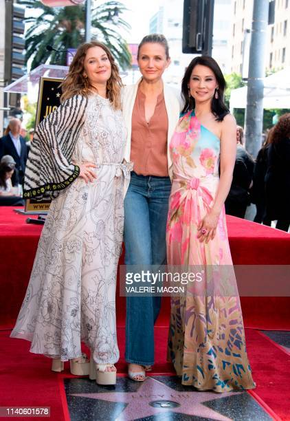 Actress Drew Barrymore Cameron Diaz and Lucy Liu stand on the star during Liu's Walk of Fame ceremony in Hollywood on May 1 2019 Lucy Liu's star is...