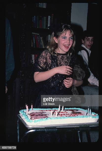 Actress Drew Barrymore gets ready to blow out candles on her 10th Birthday cake