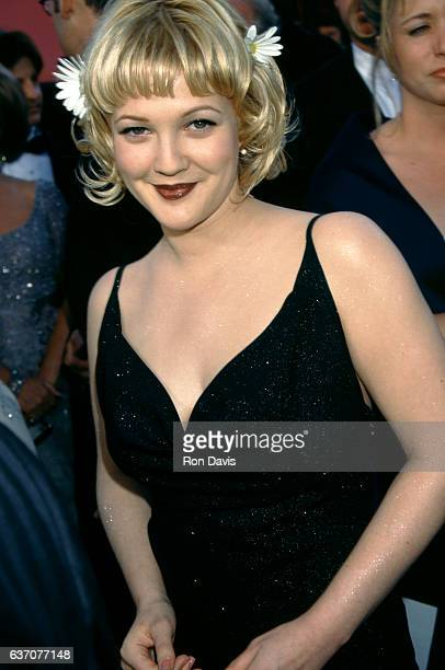 Actress Drew Barrymore poses for a portrait during The 70th Annual Academy Awards Red Carpet on March 23 1998 at the Shrine Auditorium in Los Angeles...