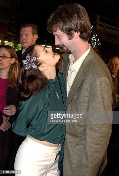 """Actress Drew Barrymore reaches to kiss fiance and co-star Tom Green at the premiere of their new film """"Charlie's Angel's"""", in Hollywood, 22 October..."""