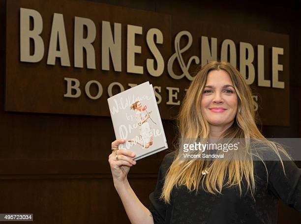 """Actress Drew Barrymore signs copies of her new book """"Wildflower"""" at Barnes & Noble at The Grove on November 4, 2015 in Los Angeles, California."""