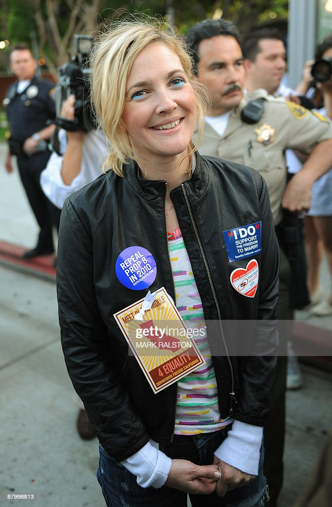 Actress Drew Barrymore smiles as she waits to speak during a Gay rights protest rally in Hollywood on May 26, 2009. California's Supreme Court upheld a referendum that outlawed gay marriage, but said 18,000 same-sex weddings carried out before the ban would remain valid. Gay and lesbian activists had sought to overturn the result of a November referendum, known as Proposition 8, which redefined marriage in California as being unions between men and women only. AFP PHOTO/Mark RALSTON