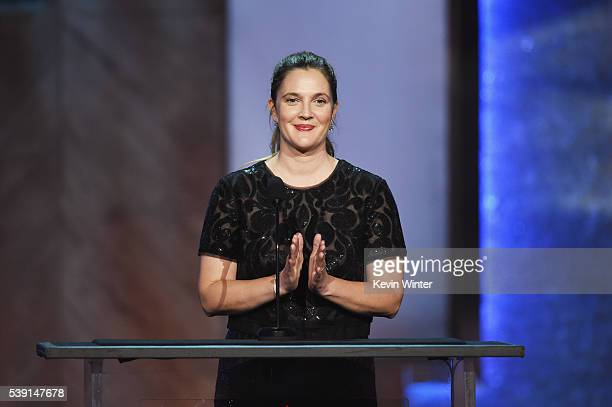 Actress Drew Barrymore speaks onstage during American Film Institute's 44th Life Achievement Award Gala Tribute to John Williams at Dolby Theatre on...