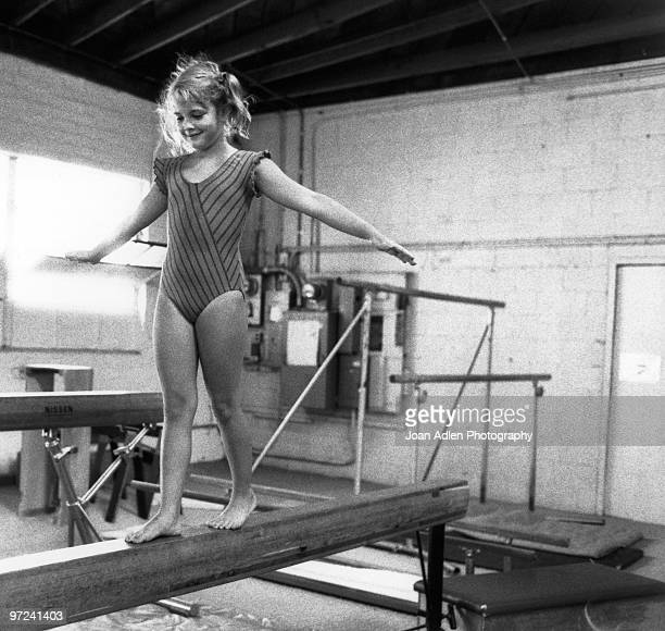 Actress Drew Barrymore walks the beam at the Junior Gym on August 15 1983 in Santa Monica California