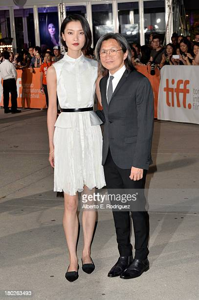 Actress Du Juan and director/producer Peter Hosun Chan arrive at the American Dreams Premiere during the 2013 Toronto International Film Festival at...