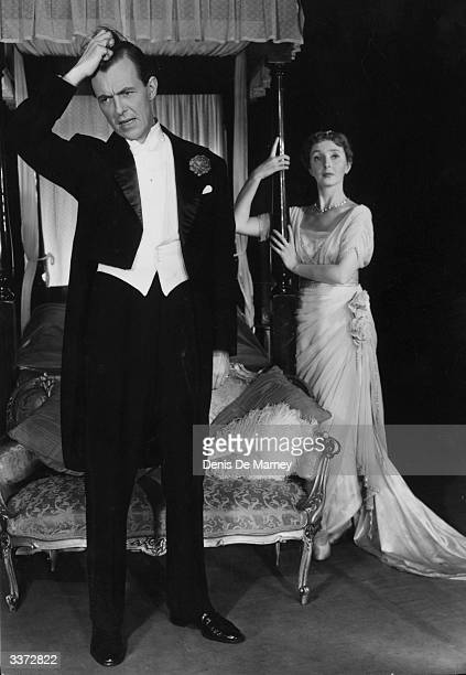 Actress Dulcie Gray and her real life husband and fellow actor Michael Denison in a scene from the play 'The Four Poster' at the Ambassadors' Theatre...
