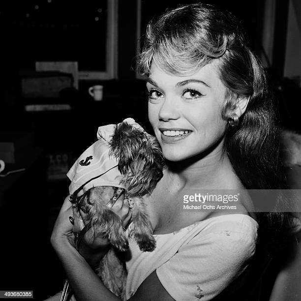 Actress Dyan Cannon poses with her dog in Los Angeles California