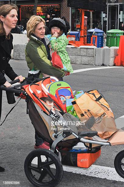 Actress Edie Falco Anderson Falco and Macy Falco walk in Tribeca on December 15 2011 in New York City