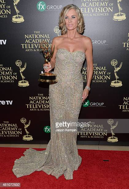 Actress Eileen Davidson poses in the press room with the Outstanding Lead Actress in a Drama Series award for Days of Our Lives during The 41st...