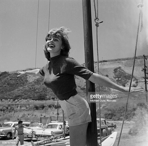 Actress Elaine Stewart poses on a boat during the Thalians Beach Ball in MalibuCalifornia