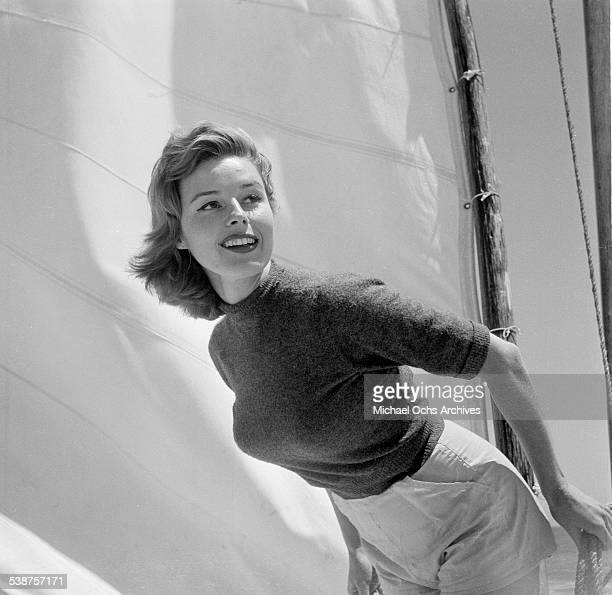 Actress Elaine Stewart poses on a sailboat during the Thalians Beach Ball in MalibuCalifornia