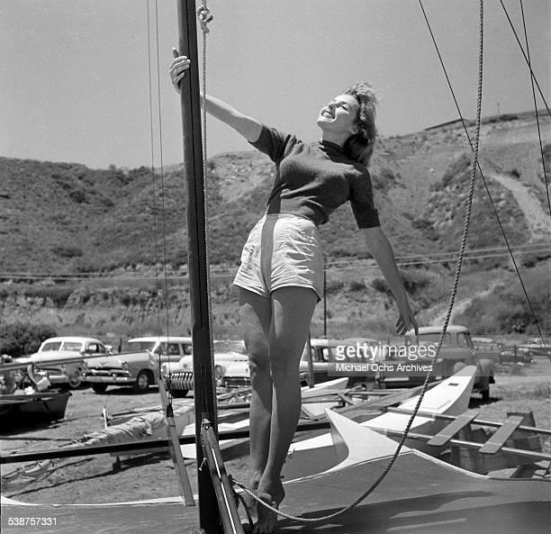 Actress Elaine Stewart poses on a sailboat during the Thalians Beach Ball in MalibuCalifornia