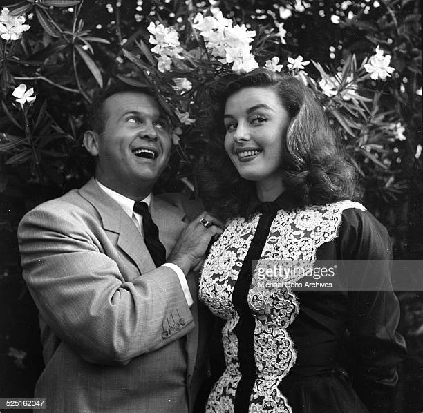 Actress Elaine Stewart with radio personality Johnny Grant attend the Garden party by Jimmy McHugh in Los AngelesCA