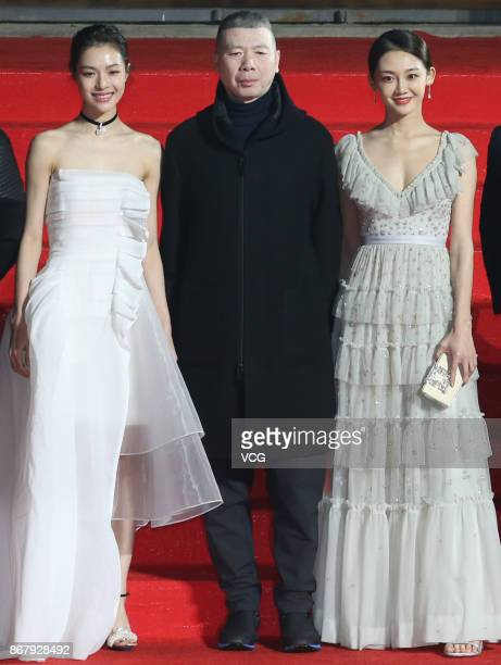 Actress Elaine Zhong Chuxi director Feng Xiaogang and actress Miao Miao arrive at the red carpet of the 1st Pingyao Crouching Tiger Hidden Dragon...