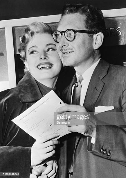 Actress Eleanor Parker, heading for her third try at matrimonial success, and artist Paul Clemens, are shown after they took out their wedding...