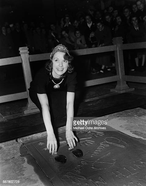 Actress Eleanor Powell has her hands added to cement in front of Grauman's Chinese Theatre in Los Angeles California