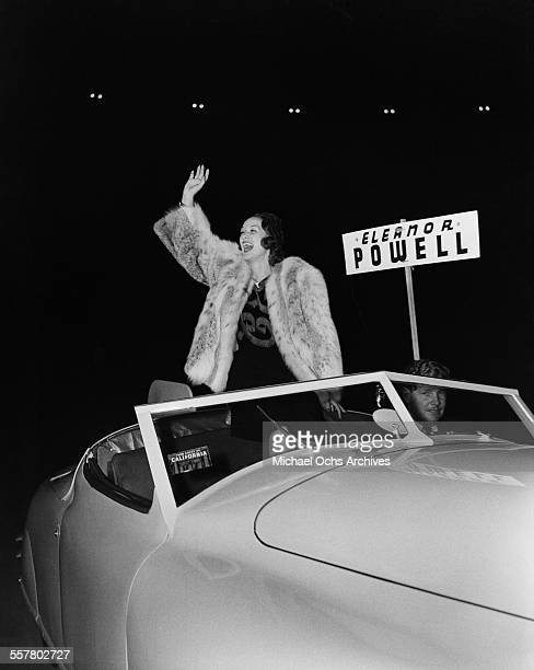 Actress Eleanor Powell waves to fans during the Hollywood Chirstmas Parade in Los Angeles California