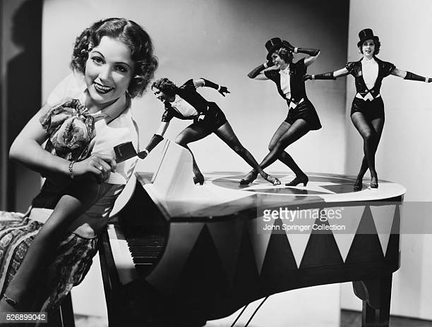 Actress Eleanor Powell with Figurines of Herself Dancing