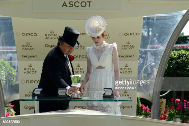 Actress Eleanor Tomlinson presents the Jersey Stakes prize on day 2 of Royal Ascot at Ascot Racecourse on June 21 2017 in Ascot England