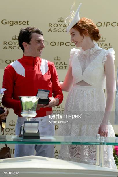 Actress Eleanor Tomlinson presents the Jersey Stakes Trophy to jockey Pierre-Charles Boudot on day 2 of Royal Ascot at Ascot Racecourse on June 21,...