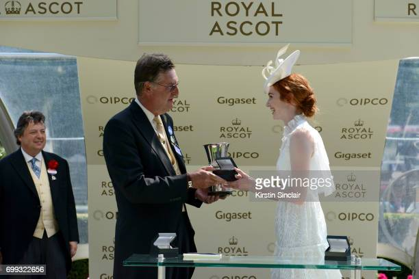 Actress Eleanor Tomlinson presents the Jersey Stakes Trophy to the 'Le Brivido' team on day 2 of Royal Ascot at Ascot Racecourse on June 21 2017 in...