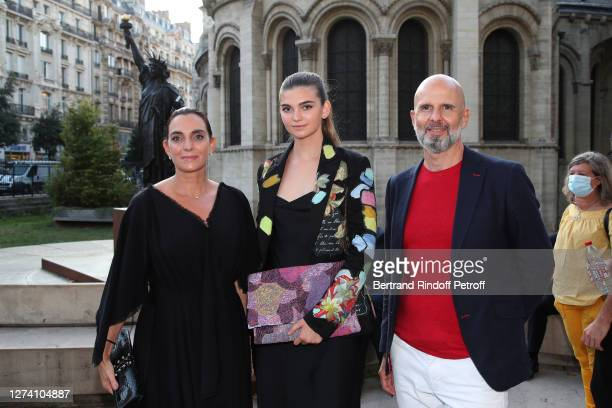 """Actress Elena Berbinau standing between her mother Sophie Gassmann and her father Francois Berbinau attend the """"Il Medico Della Peste"""" Franck Sorbier..."""