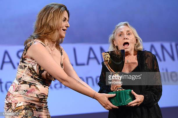 Actress Elena Cotta accepts Coppa Volpi for Best Actress for 'Via Castellana Bandiera' from Jury member Martina Gedeck on stage during the Closing...