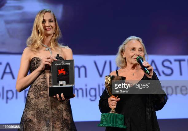 Actress Elena Cotta holds the Coppa Volpi award for best actress in 'Via Castellana Bandiera' before receiving a JaegerLeCoultre engraved Reverso...