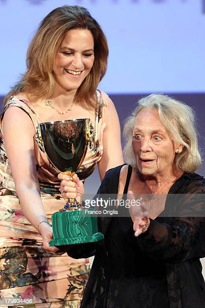 Actress Elena Cotta receives from Martina Gedeck the Best Actress Award for her role in the movie 'Via Castellana Bandiera' as she attends the...