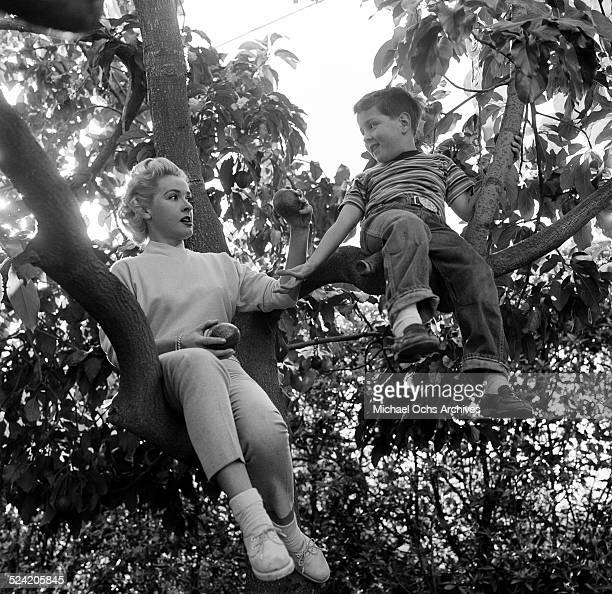 Actress Elena Verdugo picks apples with her son Richard at home in Los AngelesCA