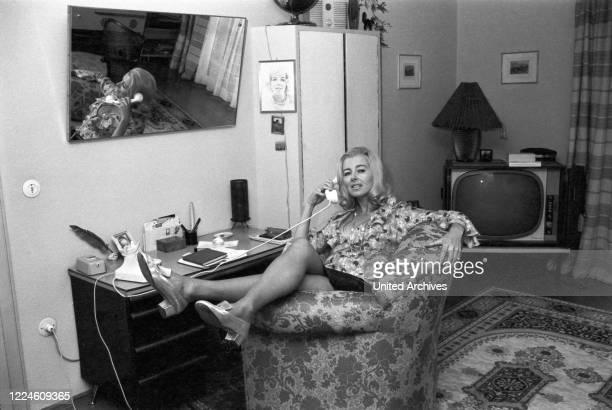 Actress Elga Machaty doing a photo shoot, Germany, 1960s.