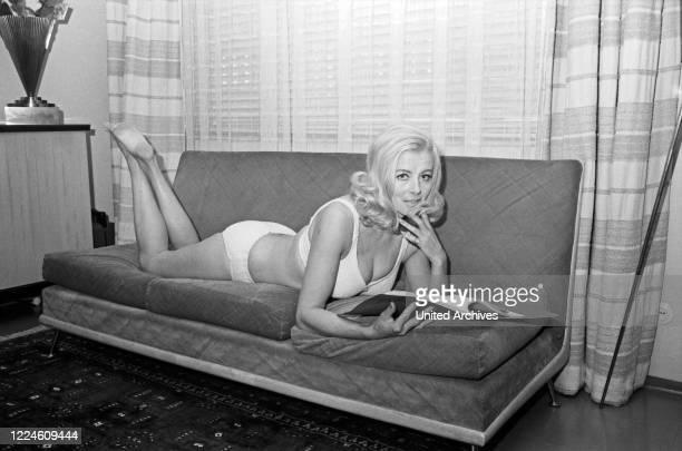 Actress Elga Machaty doing a photo shoot wearing a bikini, Germany, 1960s.