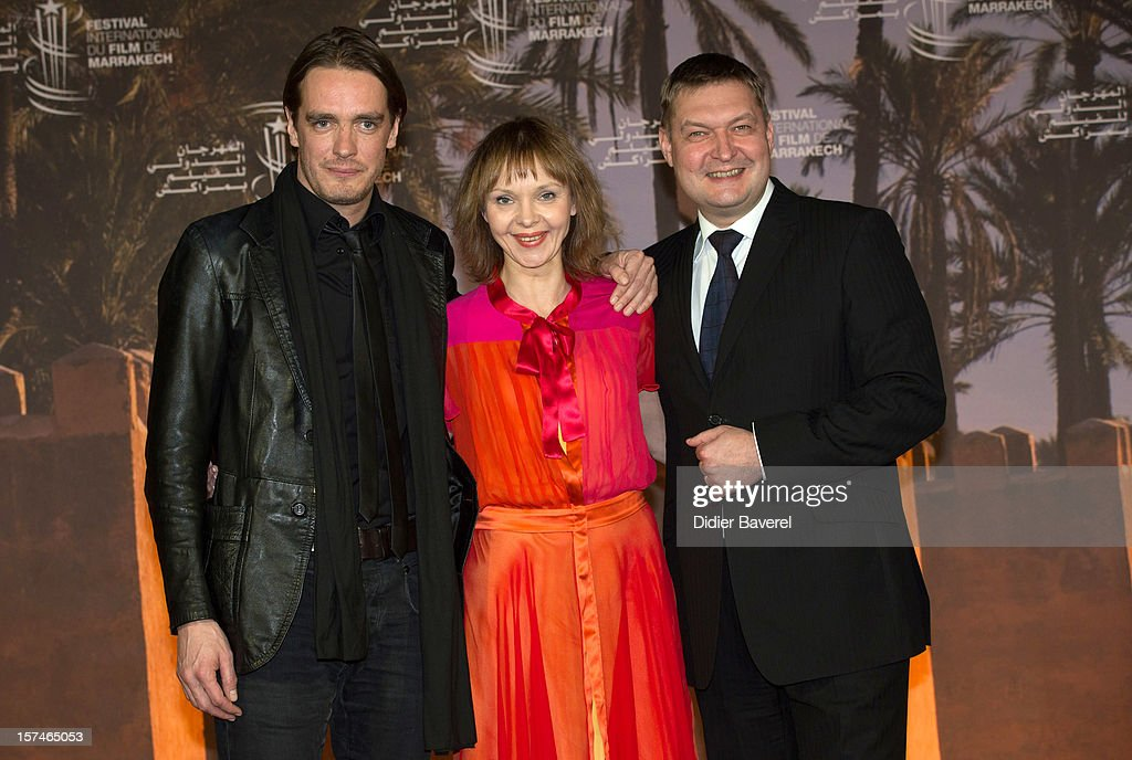 Actress Elina Reinold and actors Juhan Ulfsak (L) and Raivo E.Tamm (R) pose during a photocall of the movie ' Mushrooming' at the 12th International Marrakech Film Festival on December 3, 2012 in Marrakech, Morocco.