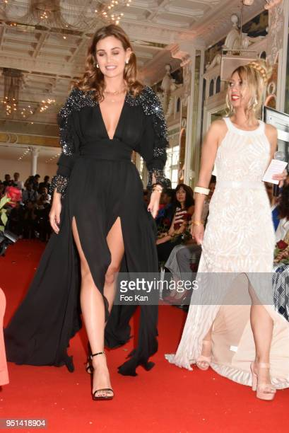 Actress Elisa Bachir Bey walks the Runway during 'Fashion Night Couture' 8th Edition at Galerie de Miroirs on April 25 2018 in Paris France